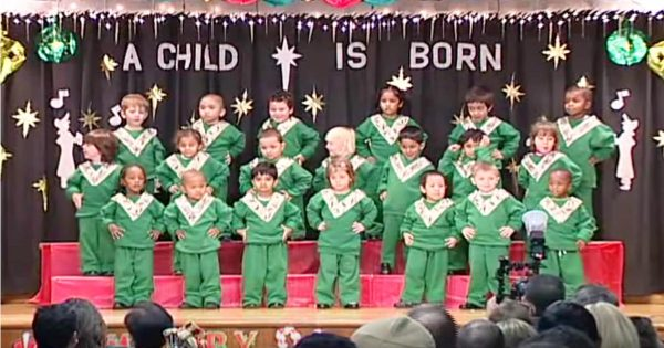 "Kids line up on stage for school Christmas recital – crack audience up when they start to ""shake"" their bodies"