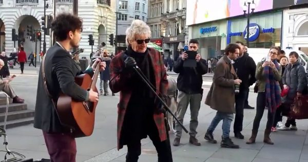 Legendary rock star hears street busker singing his voice – joins in and stuns crowd with impromptu incredible performance