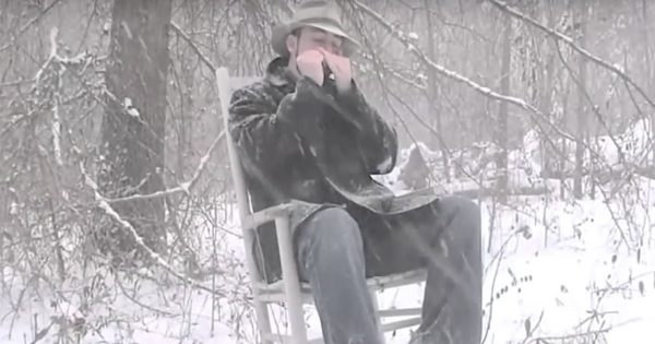 """Alone in the snow, man plays chilling cover of """"Amazing Grace"""" on his harmonica"""