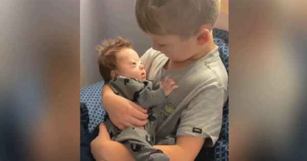 Boy sings to baby brother with Down syndrome and the song couldn't be sweeter