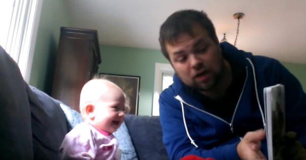Uncle reads story to baby using animated voices. Seconds later, they're both crying with laughter