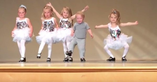 Toddler interrupts girls' school dance routine, steals the spotlight with hilarious moves