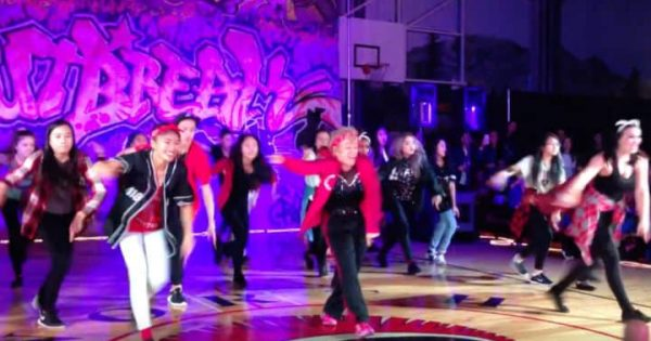 60-year-old retiring teacher joins students in energetic Uptown Funk routine and completely outshines them all