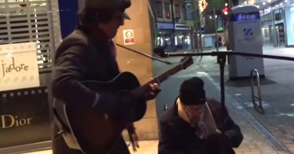 Homeless man asks to sing with street musician. Moment he starts to sing, passersby freeze in their tracks